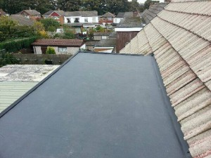 Laying out rubber on roof dormer