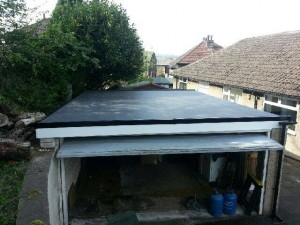 Completed roofing work on a garage